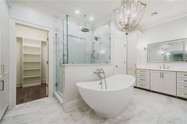 Custom glass shower, marble flooring